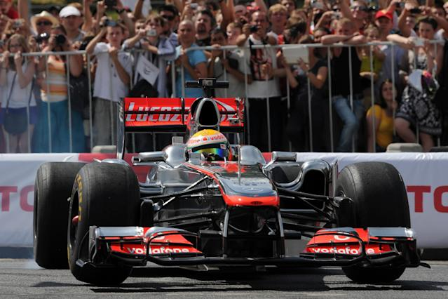 """Formula One McLaren Mercedes' British driver Lewis Hamilton speeds during the """"Moscow City Racing"""" show on July 15, 2012 in central Moscow. AFP PHOTO / KIRILL KUDRYAVTSEVKIRILL KUDRYAVTSEV/AFP/GettyImages"""