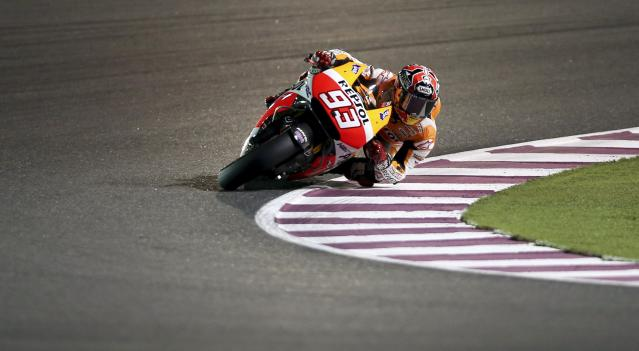 Honda MotoGP rider Marc Marquez of Spain races during a free practice session at the MotoGP World Championship at the Losail International circuit in Doha March 21, 2014. REUTERS/Fadi Al-Assaad (QATAR - Tags: SPORT MOTORSPORT)