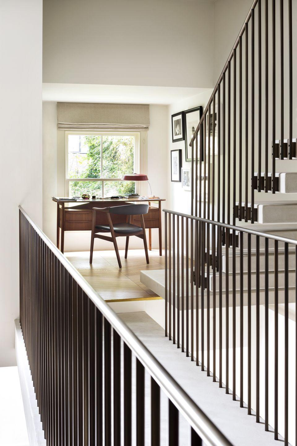 """<p>The perfect example of a unique space that's been brilliantly capitalised on. This desk occupies a sunny spot by the window on the landing of a London home designed by architecture firm Michaelis Boyd. Not every home may have a central staircase with this much drama but, whatever size, the landing is often an area with underused space. <a href=""""https://www.michaelisboyd.com/"""" rel=""""nofollow noopener"""" target=""""_blank"""" data-ylk=""""slk:michaelisboyd.com"""" class=""""link rapid-noclick-resp"""">michaelisboyd.com</a></p>"""