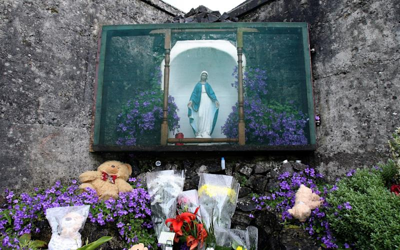 a shrine in Tuam, County Galway  erected in memory of up to 800 children who were allegedly buried at the site - AFP or licensors