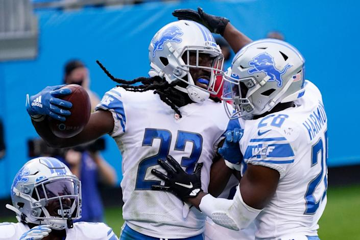Lions cornerback Desmond Trufant celebrates with strong safety Duron Harmon, right, after an interception in the end zone during the second half of the Lions' 20-0 loss to the Panthers on Sunday, Nov. 22, 2020, in Charlotte, North Carolina.