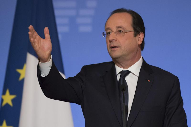 France's President Francois Hollande, gestures as he speaks to the ambassadors during a New Year's speech to he foreign ambassadors to France at the Elysee Palace in Paris, Friday, Jan. 17, 2014. (AP Photo/Michel Euler, Pool)