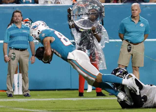 Miami Dolphins wide receiver Danny Amendola (80) dives into the end zone for a touchdown as he is tackled by Baltimore Ravens defensive back Tony Jefferson, bottom right, during the first half of a preseason NFL football game, Saturday, Aug. 25, 2018, in Miami Gardens, Fla