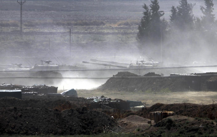 In this Sunday, Oct. 6, 2019 photo, Turkish forces artillery pieces are driven to their new positions near the border with Syria in Sanliurfa province, Turkey. U.S.-backed Kurdish-led forces in Syria said American troops began withdrawing Monday from their positions along Turkey's border in northeastern Syria, ahead of an anticipated Turkish invasion that the Kurds say will overturn five years of achievements in the battle against the Islamic State group. (DHA via AP)