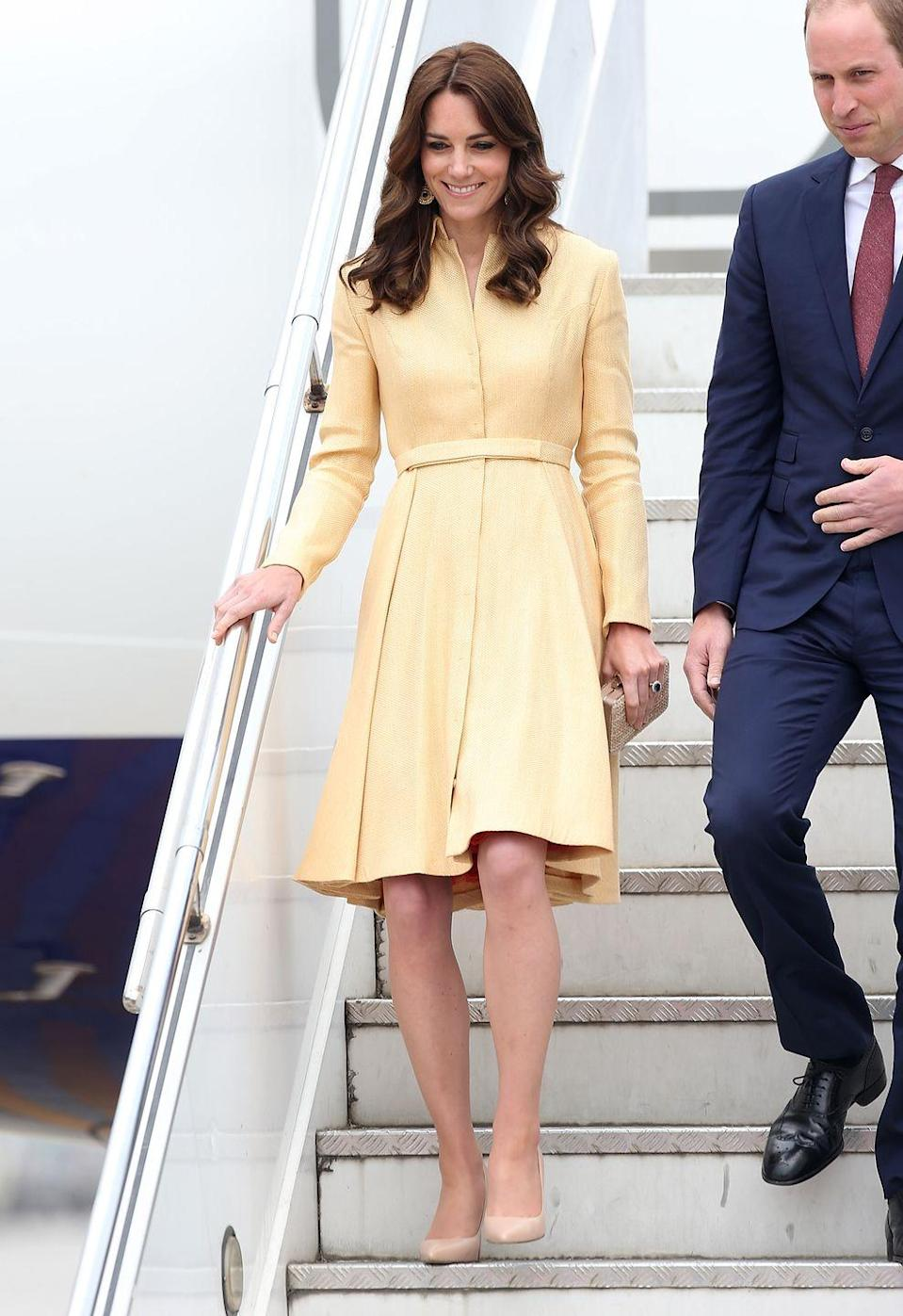<p>It took four years for Kate to rewear the coat dress, but she did it! She stepped off the plane in Thimphu, Bhutan, to greet her hosts wearing sunny yellow. </p>