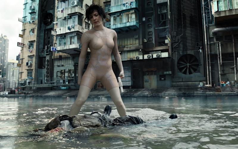 "In this image released by Paramount Pictures, Scarlett Johansson appears in a scene from, ""Ghost in the Shell."" (Paramount Pictures and DreamWorks Pictures via AP)"
