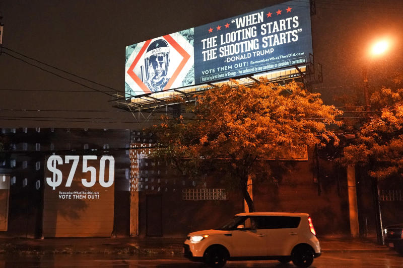 A projection is shown on a building Monday, Sept. 28, 2020, in Cleveland, by Robin Bell, an American multimedia visual artist, with the words President Donald Trump used when he talked about the coronavirus on Jan. 22, 2020. Trump paid $750 in U.S income taxes in 2016 and 2017. The billboard art was created by Shepard Fairey. (Tony Dejak/AP)