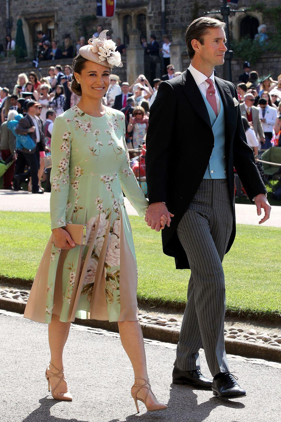 """<p>Arriving at the Royal Wedding of Price Harry and Meghan Markle in a floral <a rel=""""nofollow noopener"""" href=""""https://thefoldlondon.com/product/hepburn-dress-bloom-print-silk/?"""" target=""""_blank"""" data-ylk=""""slk:The Fold"""" class=""""link rapid-noclick-resp"""">The Fold</a> dress and nude heels. </p>"""