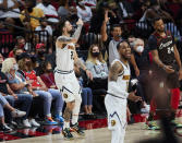 Denver Nuggets guard Austin Rivers, left, reacts after making a 3-point basket against the Portland Trail Blazers during the second half of Game 6 of an NBA basketball first-round playoff series Thursday, June 3, 2021, in Portland, Ore. (AP Photo/Craig Mitchelldyer)