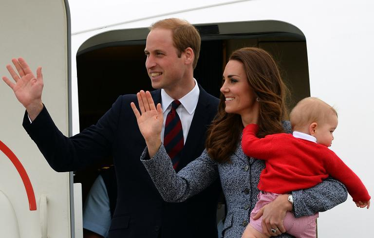 Britain's Prince William (L), his wife Catherine and their son Prince George depart in Canberra on April 25, 2014