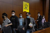 Hong Kong's pro-democracy legislators leave after a press conference at the Legislative Council in Hong Kong, Monday, Nov. 9, 2020. The lawmakers said Monday that they would resign en masse if Beijing disqualifies any of them. The announcement came amid unconfirmed reports that Beijing would oust four legislators for filibustering meetings and violating their oath. (AP Photo/Vincent Yu)