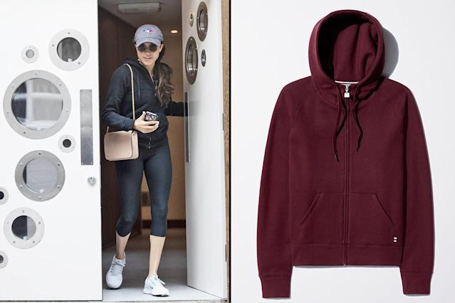 "<p>In May 2017, Markle stepped out in a low-key outfit: an Aritzia hoodie in black, cropped leggings, sneakers, and a baseball cap. The Aritzia Tna Pacific hoodie has sold out, but you can still buy a similar version. (Photo: The Image Direct; courtesy of Aritzia)<br>Shop similar version: Aritzia Wilfred Free Brina Sweater, $43, <a href=""https://us.aritzia.com/product/brina-sweater/65086.html?dwvar_65086_color=169"" rel=""nofollow noopener"" target=""_blank"" data-ylk=""slk:aritzia.com"" class=""link rapid-noclick-resp"">aritzia.com </a> </p>"