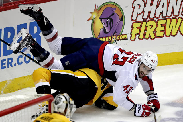Washington Capitals' Tom Wilson (43) collides with Pittsburgh Penguins' Marcus Pettersson (28) during the first period of an NHL hockey game in Pittsburgh, Tuesday, March 12, 2019. (AP Photo/Gene J. Puskar)