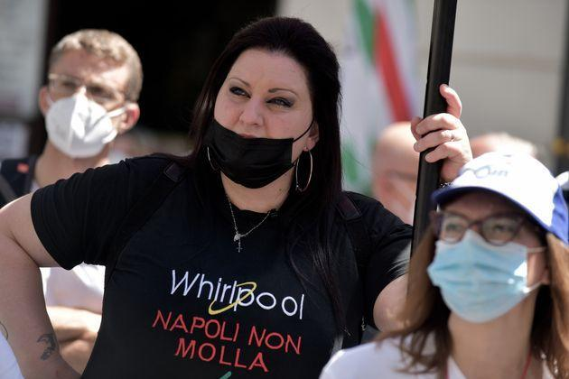 ROME, ITALY - MAY 27: Workers of the multinational Whirlpool wear T-shirts with the words 'Napoli non Molla' during the demonstration in Rome against the redundancies and the closure of the Naples plant, on May 27, 2021 in Rome, Italy. (Photo by Simona Granati - Corbis/Corbis via Getty Images) (Photo: Simona Granati - Corbis via Getty Images)