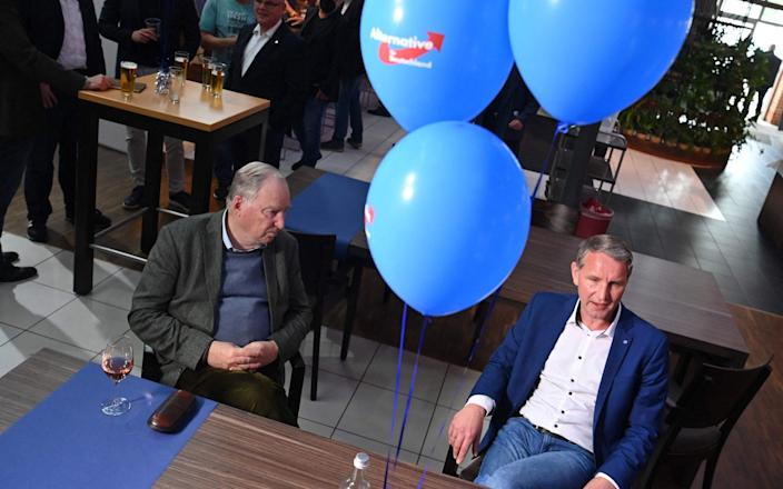Alexander Gauland (L), parliamentary group co-leader of Germany's far-right Alternative for Germany (AfD) party, and Thuringia's AfD leader Bjoern Hoecke sit at the party's venue as they await the results in the regional elections in the German state of Saxony-Anhalt, in Magdeburg, eastern Germany, on June 6, 2021, during. - Germans in the eastern state of Saxony-Anhalt headed to the polls on June 6, with the far-right posing a tough challenge to Chancellor Merkel's conservatives in the final major test before the first general election in 16 years not to feature the veteran chancellor. (Photo by John MACDOUGALL / AFP) (Photo by JOHN MACDOUGALL/AFP via Getty Images) - JOHN MACDOUGALL/AFP
