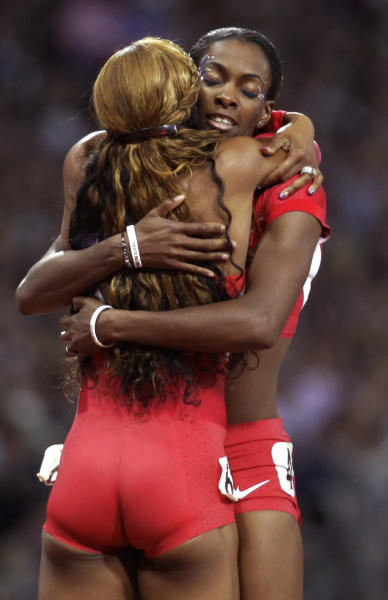 Sanya Richards-Ross from the U.S., right, hugs compatriot DeeDee Trotter after the women's 400-meter during the athletics competition in the Olympic Stadium at the 2012 Summer Olympics, London, Sunday, Aug. 5, 2012. Richards-Ross won the gold, Trotter the bronze. (AP Photo/Lee Jin-man)