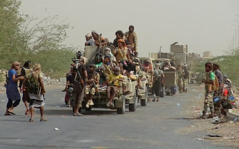 <span>Yemeni pro-government forces gather on the eastern outskirts of Hodeida</span> <span>Credit: AFP </span>