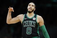 Boston Celtics' Jayson Tatum reacts after making a three-point basket during the second half of an NBA basketball game against the Charlotte Hornets in Boston, Sunday, Dec. 22, 2019. (AP Photo/Michael Dwyer)