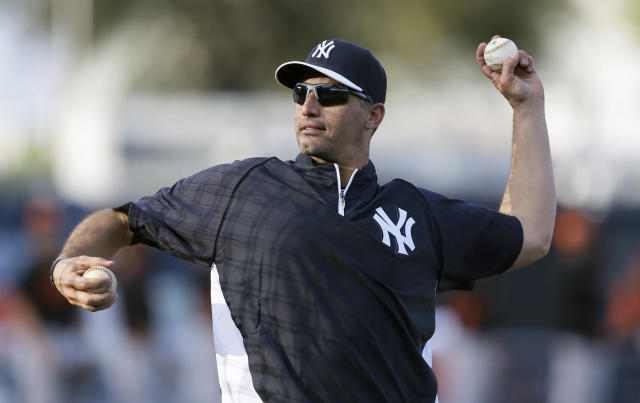 Former New York Yankees pitcher Andy Pettitte throws a pitch during batting practice before an exhibition baseball game against the Baltimore Orioles Tuesday, March 4, 2014, in Tampa, Fla. (AP Photo/Charlie Neibergall)