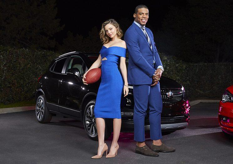 Miranda Kerr and Cam Newton teamed up for Buick's Super Bowl ad, featuring the Encore SUV and Cascada convertible.
