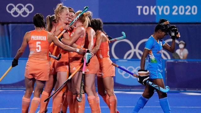The Netherlands women's hockey team celebrate a goal during their Pool A clash against India. AP