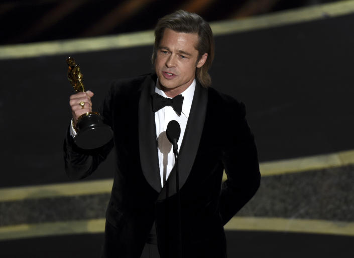 """Brad Pitt accepts the award for best performance by an actor in a supporting role for """"Once Upon a Time in Hollywood"""" at the Oscars on Sunday, Feb. 9, 2020. (AP Photo/Chris Pizzello)"""