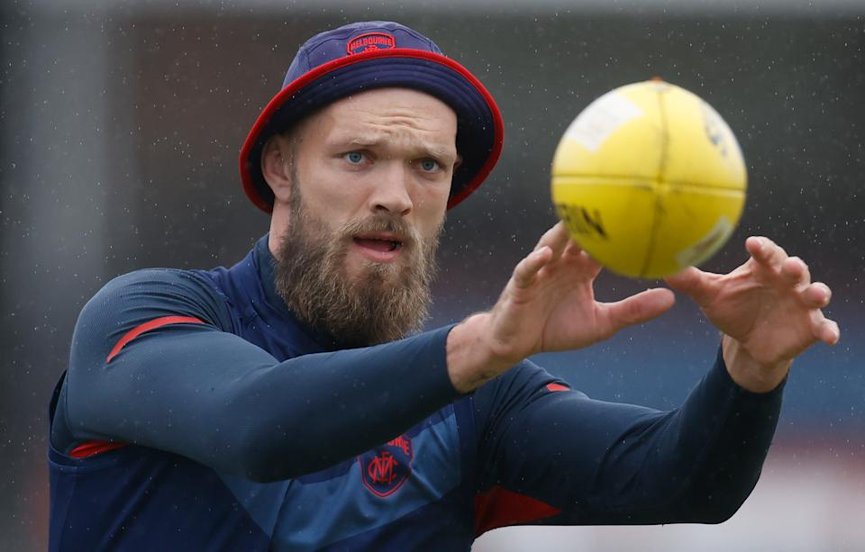 Max Gawn (pictured) catching a ball during the Melbourne Demons training session.