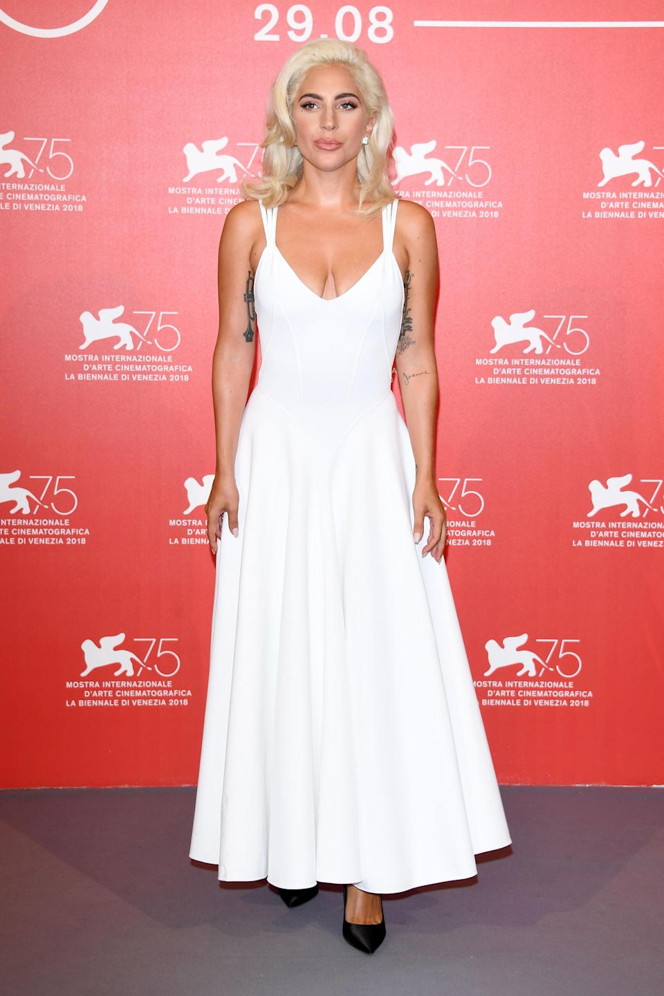 <p>Gaga wore vintage Azzedine Alaia for the photocall of her film. </p>
