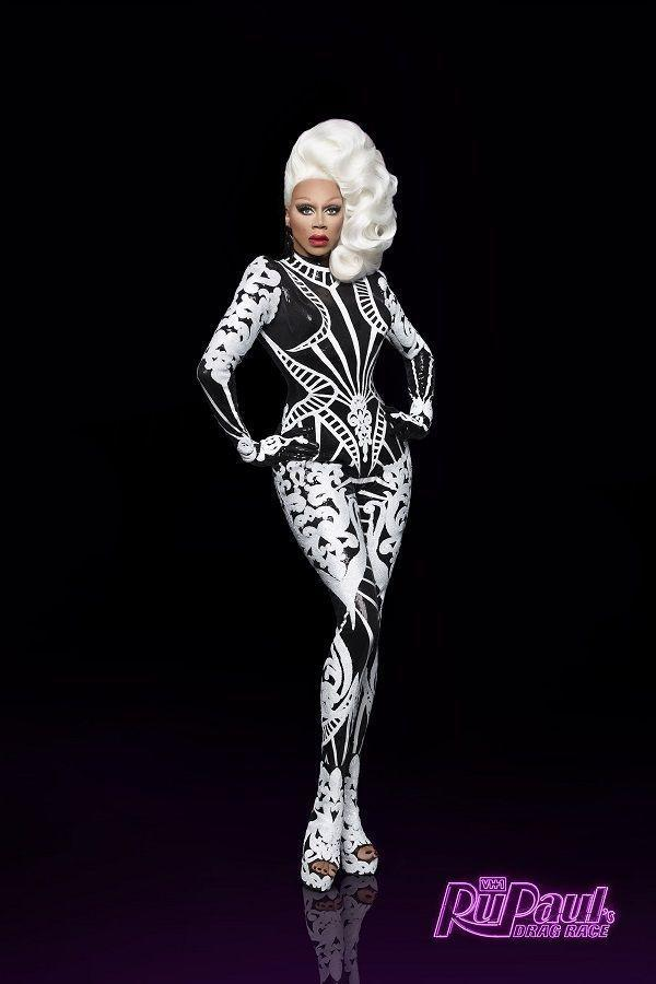 <p>And while his public looks now are mostly suits, you can still see Ru in drop dead drag and wigs weekly (like this black and white number) on the runway of<em> RuPaul's Drag Race.</em></p>