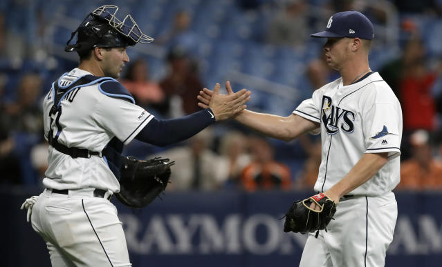 Tampa Bay Rays pitcher Emilio Pagan, right, celebrates with catcher Mike Zunino after closing out the Baltimore Orioles during the ninth inning of a baseball game Wednesday, April 17, 2019, in St. Petersburg, Fla. (AP Photo/Chris O'Meara)