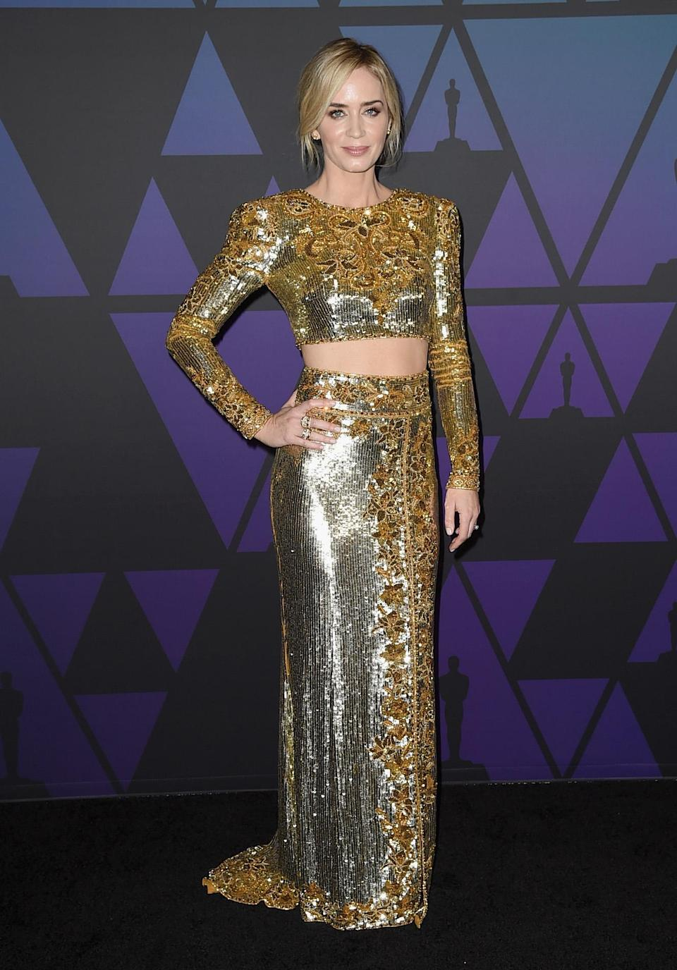 <p>Emily Blunt wore a custom DUNDAS by Peter Dundas gold embroidered top and skirt ensemble to attend the Academy of Motion Picture Arts and Sciences' 10th annual Governors Awards at The Ray Dolby Ballroom at Hollywood & Highland Center on November 18, 2018 in Hollywood, California. <em>[Photo: Getty]</em> </p>