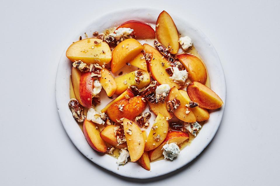 """The combination of ripe stone fruit, candied pecans, Gorgonzola, and a sweet herb syrup hugs the line between savory and sweet, meaning you can serve this recipe as a summer salad or a light dessert. This recipe was reader-requested from <a href=""""https://thymecafeandmarket.com/"""" rel=""""nofollow noopener"""" target=""""_blank"""" data-ylk=""""slk:Thyme Cafe and Market"""" class=""""link rapid-noclick-resp"""">Thyme Cafe and Market</a>, Santa Monica, CA. <a href=""""https://www.bonappetit.com/recipe/nectarines-and-peaches-with-lavender-syrup?mbid=synd_yahoo_rss"""" rel=""""nofollow noopener"""" target=""""_blank"""" data-ylk=""""slk:See recipe."""" class=""""link rapid-noclick-resp"""">See recipe.</a>"""