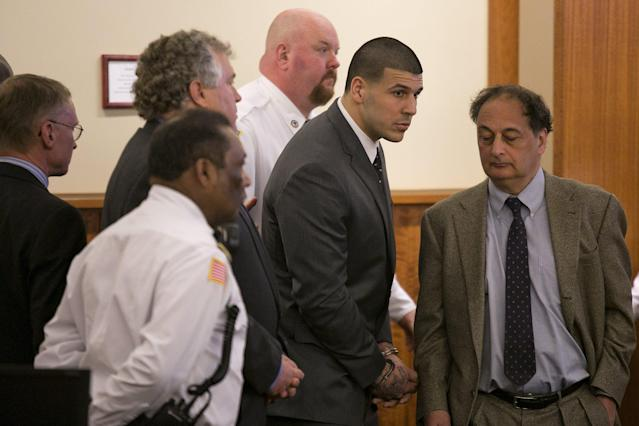 Former NFL player Aaron Hernandez listens after he was sentenced to life in prison during his murder trial at the Bristol County Superior Court in Fall River, Massachusetts, April 15, 2015. Hernandez, 25, a former tight end for the New England Patriots, is convicted of fatally shooting semiprofessional football player Odin Lloyd in an industrial park near Hernandez's Massachusetts home in June 2013. REUTERS/Dominick Reuter