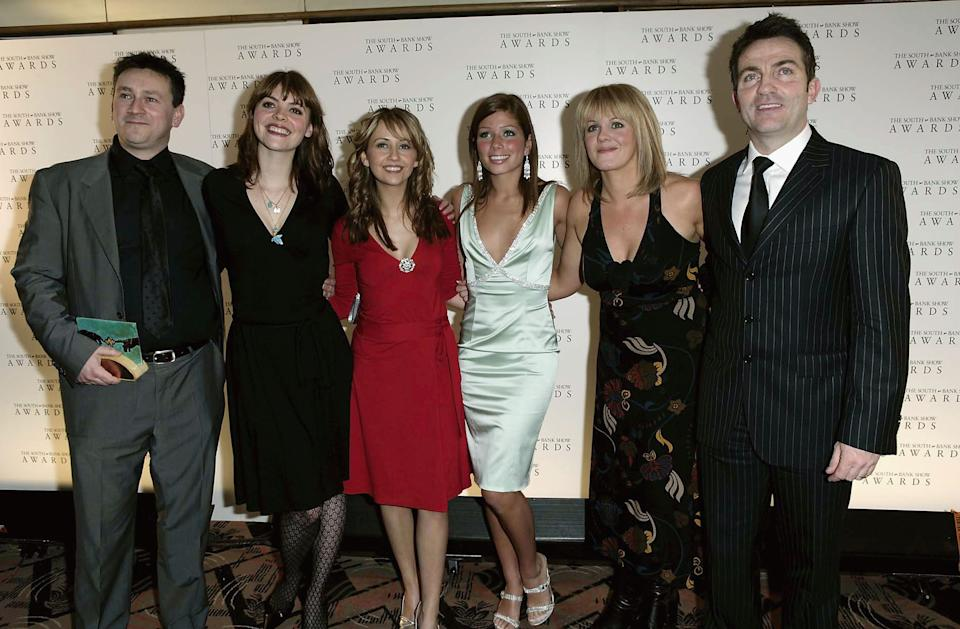 LONDON - JANUARY 27: (UK TABLOID NEWSPAPERS OUT) Producer Tony Wood (L) and members of the cast of Coronation Street (L-R) Kate Ford, Samia Ghadie, Nikki Sanderson, Sally Lindsay and Bradley Walsh pose with the TV Drama award at the South Bank Show Awards at The Savoy on January 27, 2005 in London. The annual awards recognise excellence in everything from opera to pop music and literature to visual art, with a special award for outstanding achievement, and a Breakthrough Award chosen by readers of The Times. (Photo by Claire Greenway/Getty Images)