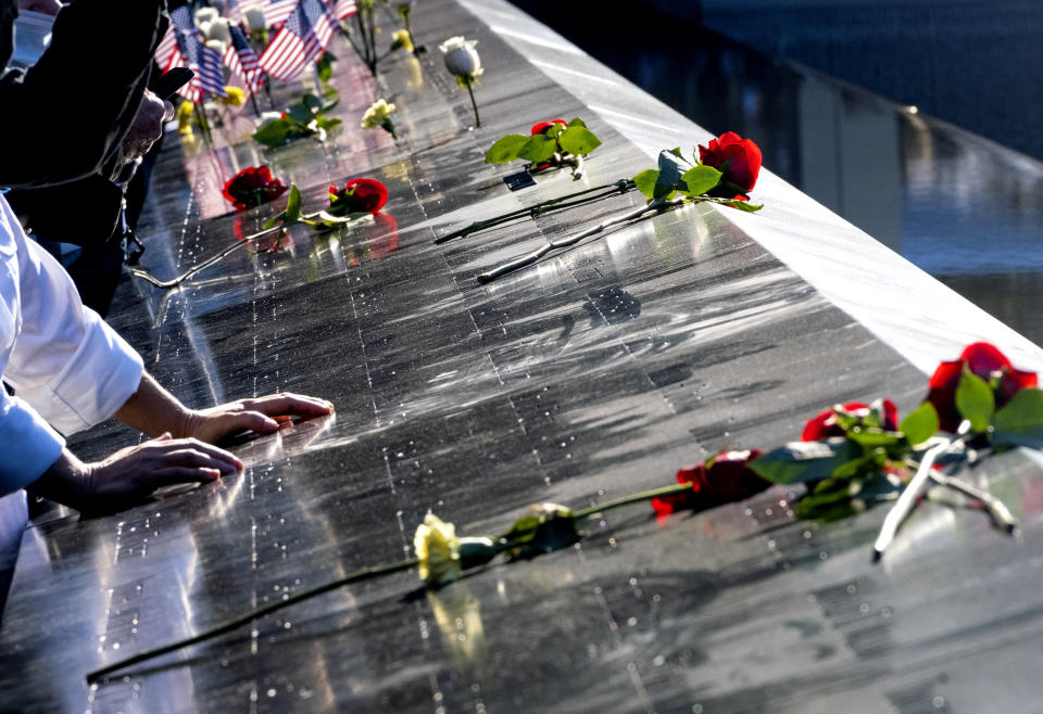Flowers adorn the names of people who were killed during the attacks on the World Trade Center on Sept. 11, 2001, as families gather at the National September 11 Memorial in New York on the 20th anniversary of the attacks, Saturday, Sept. 11, 2021. (Craig Ruttle/Newsday via AP, Pool)