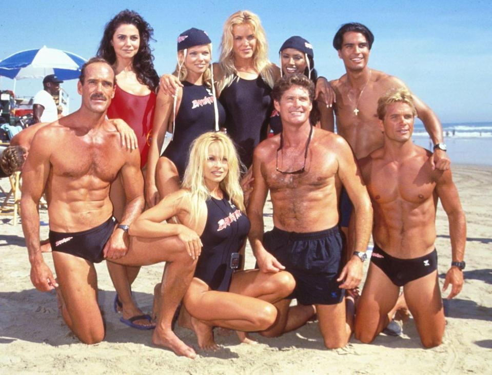 <p>The cast of <em>Baywatch</em> poses together at Huntington Beach, California. </p>