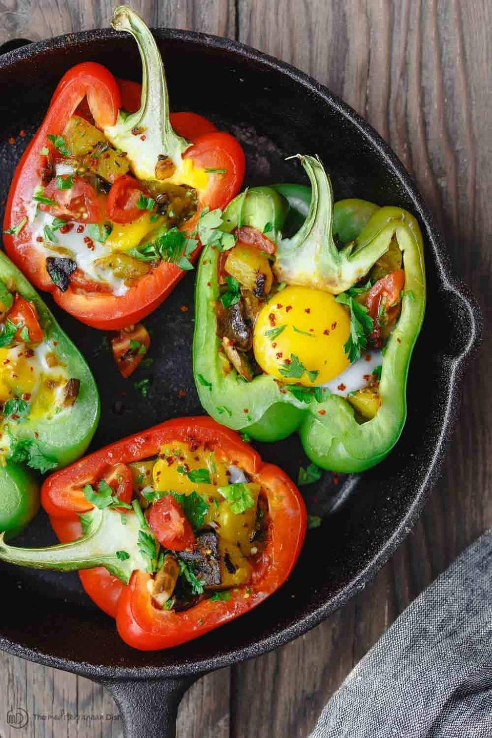"""<p>Colorful bell peppers make the perfect vessel for vegetarian potato hash and a deliciously runny egg. No toast needed!</p><p><strong>Get the recipe at <a href=""""https://www.themediterraneandish.com/easy-stuffed-peppers/"""" rel=""""nofollow noopener"""" target=""""_blank"""" data-ylk=""""slk:The Mediterranean Dish"""" class=""""link rapid-noclick-resp"""">The Mediterranean Dish</a>.</strong></p><p><strong><a class=""""link rapid-noclick-resp"""" href=""""https://go.redirectingat.com?id=74968X1596630&url=https%3A%2F%2Fwww.walmart.com%2Fsearch%2F%3Fquery%3Dpioneer%2Bwoman%2Bcast%2Biron%2Bskillet&sref=https%3A%2F%2Fwww.thepioneerwoman.com%2Ffood-cooking%2Fmeals-menus%2Fg34922086%2Fhealthy-breakfast-ideas%2F"""" rel=""""nofollow noopener"""" target=""""_blank"""" data-ylk=""""slk:SHOP CAST IRON SKILLETS"""">SHOP CAST IRON SKILLETS</a><br></strong></p>"""