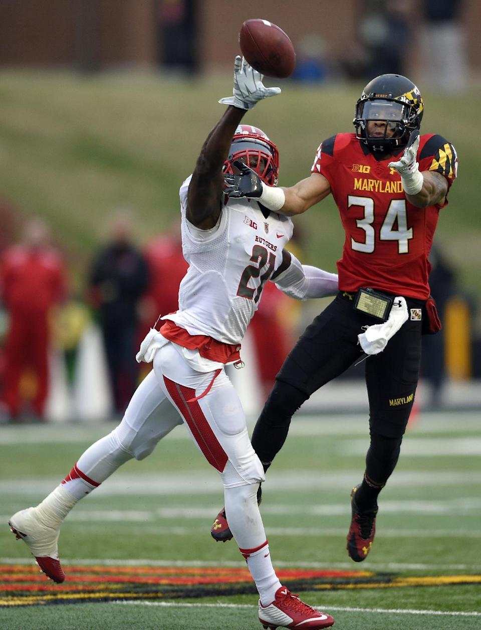 Rutgers defensive back Lorenzo Waters (21) breaks up a pass against Maryland wide receiver Jacquille Veii (34) during the first half of an NCAA college football game, Saturday, Nov. 29, 2014, in College Park, Md. (AP Photo/Nick Wass)