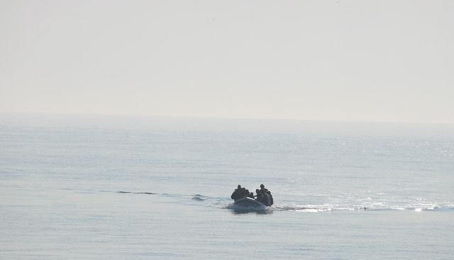 A group of people thought to be migrants arrive in an inflatable boat at Kingsdown beach, near Dover, Kent (Gareth Fuller/PA)