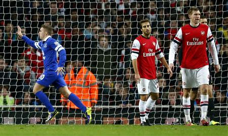 Everton's Gerard Deulofeu (L) celebrates scoring during their English Premier League soccer match against Arsenal at The Emirates in London, December 8, 2013. REUTERS/Andrew Winning