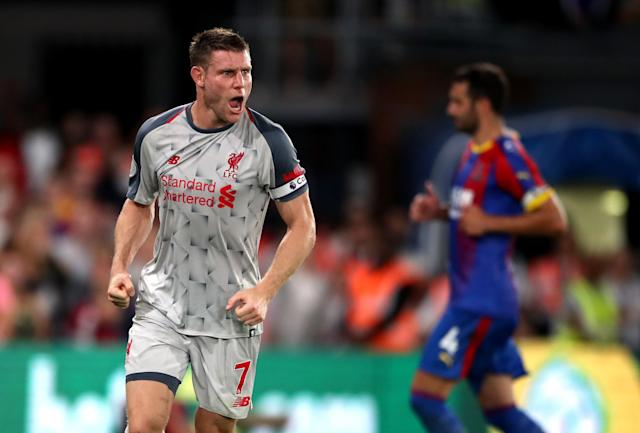 Liverpool's James Milner celebrates scoring his side's first goal of the game from the penalty spot.
