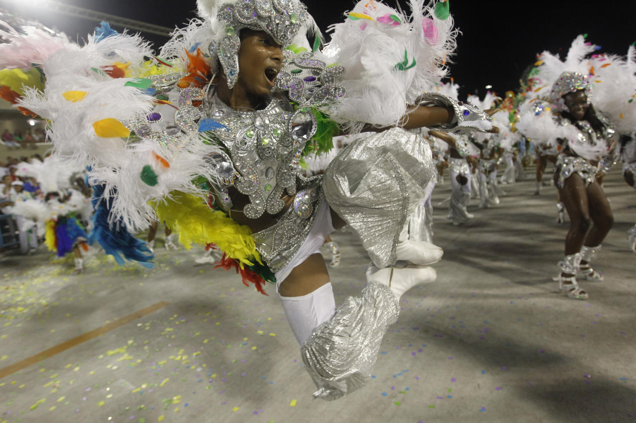 Performers from the Mocidade Independente de Padre Miguel samba school parade during carnival celebrations at the Sambadrome in Rio de Janeiro, Brazil, Monday Feb. 20, 2012. (AP Photo/Silvia Izquierdo)