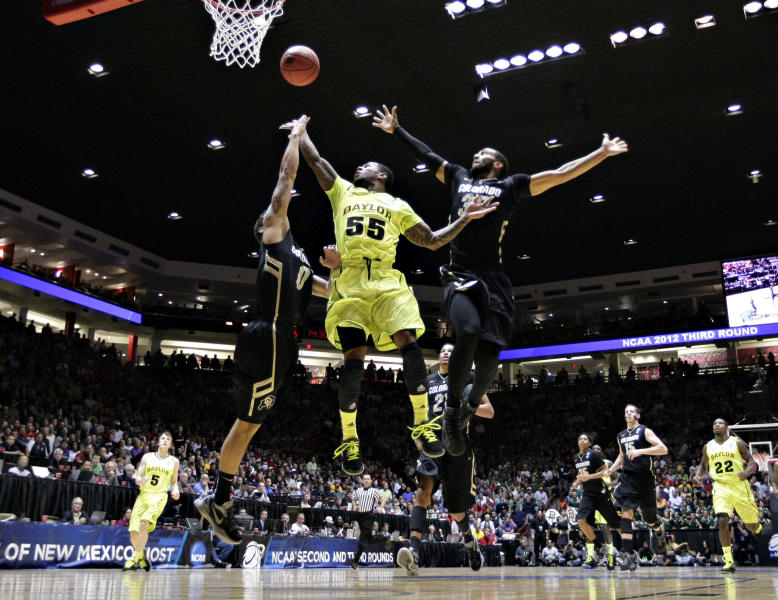 Baylor guard Pierre Jackson (55) shoots between Colorado defenders Nate Tomlinson, left, and Carlon Brown, right, during the first half of an NCAA tournament third-round college basketball game on Saturday, March 17, 2012, in Albuquerque, N.M. (AP Photo/Matt York)