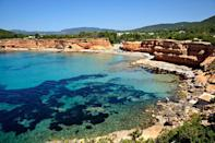 <p>Take a break from the superclubs and spend the day at Playa Sa Caleta in Ibiza. The beach is nestled between two rugged cliff faces and has plenty of hidden sunbathing spots.</p>