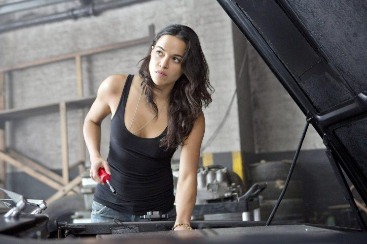 Quitting?... Michelle Rodriguez is demanding more to do for the female stars of the Fast & Furious franchise - Credit: Universal
