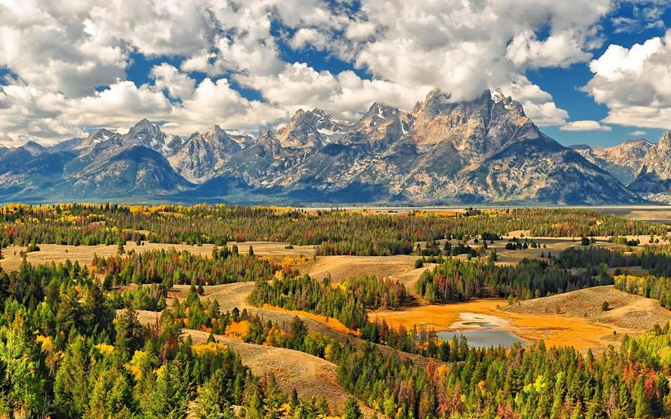 """<p>Come fall, the selfie-snapping crowds of summer road-trippers have subsided, leaving behind vistas of migrating wildlife and clear skies in Jackson Hole, in a valley ringed by the Grand Tetons. Until mid-October when the frost sets in, you'll have cool nights and warm days perfect for hiking and biking the acres of trails within the Bridger-Teton National Forest. You can still raft the Snake River, though you'll want to wear a wetsuit on the whitewater segments, and fly-fishing is amazing in the fall. </p> <p>For the best valley views, try Jackson Hole's <a href=""""https://www.jacksonhole.com/via-ferrata.html"""" rel=""""nofollow noopener"""" target=""""_blank"""" data-ylk=""""slk:Via Ferrata"""" class=""""link rapid-noclick-resp"""">Via Ferrata</a>, a guided climbing experience through the high alpine terrain via fixed cables and iron rungs, which has just been expanded with four new routes—then refuel at <a href=""""https://www.cntraveler.com/story/why-jackson-hole-is-the-perfect-ski-town?mbid=synd_yahoo_rss"""" rel=""""nofollow noopener"""" target=""""_blank"""" data-ylk=""""slk:Bar Enoteca"""" class=""""link rapid-noclick-resp"""">Bar Enoteca</a>, with its locally made charcuterie and superb wine list. Book a room at <a href=""""https://www.cntraveler.com/hotels/united-states/teton-village/four-seasons-resort--jackson-hole?mbid=synd_yahoo_rss"""" rel=""""nofollow noopener"""" target=""""_blank"""" data-ylk=""""slk:Four Seasons Resort and Residences Teton Village"""" class=""""link rapid-noclick-resp"""">Four Seasons Resort and Residences Teton Village</a> or the new <a href=""""https://www.continuumjh.com/"""" rel=""""nofollow noopener"""" target=""""_blank"""" data-ylk=""""slk:Continuum"""" class=""""link rapid-noclick-resp"""">Continuum</a>, just a mile south of the gate to Grand Teton National Park. The early morning wildlife viewing is unbeatable this time of year (expect moose and bison), and before dusk you'll hear the elk bugling while they mate and migrate. Or stay in the town of Jackson at the boutique <a href=""""https://www.cntraveler.com/hotels/jackson/hotel-jackson?"""