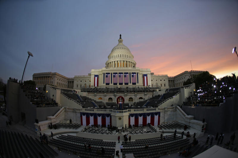 The sun rises behind the Capitol Dome early in the morning before the ceremonial swearing-in of President Barack Obama at the U.S. Capitol during the 57th Presidential Inauguration in Washington, Monday, Jan. 21, 2013. (AP Photo/Pablo Martinez Monsivais)