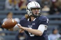 FILE - In this Nov. 18, 2017, file photo, Yale quarterback Kurt Rawlings drops back to pass against Harvard during an NCAA college football game in New Haven, Conn. Rawlings has rewritten the school's record books for passing, throwing the ball to two receivers he convinced to come with him to the Ivy League. (AP Photo/Gregory Payan, File)