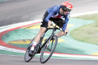 File-This Sept. 25, 2020, file photo shows United States' Brandon McNulty competing during the men's Individual Time Trial event, at the road cycling World Championships, in Imola, Italy. he cycling team that the U.S. is taking to the Tokyo Olympics is a little bit different than the one it would have taken a year ago, when the COVID-19 pandemic forced organizers to postpone the Summer Games by an entire year. In many ways, it's a whole lot stronger. Among those on the team announced Thursday, June 10, 2021, are mountain biker Haley Batten, who's been on the podium each of the first two World Cup races of the season; Megan Jastrab, the 19-year-old track cycling prodigy who will be part of the gold medal-favorite women's pursuit team and also contest the Madison; and 23-year-old time trial star McNulty. (AP Photo/Andrew Medichini, File)