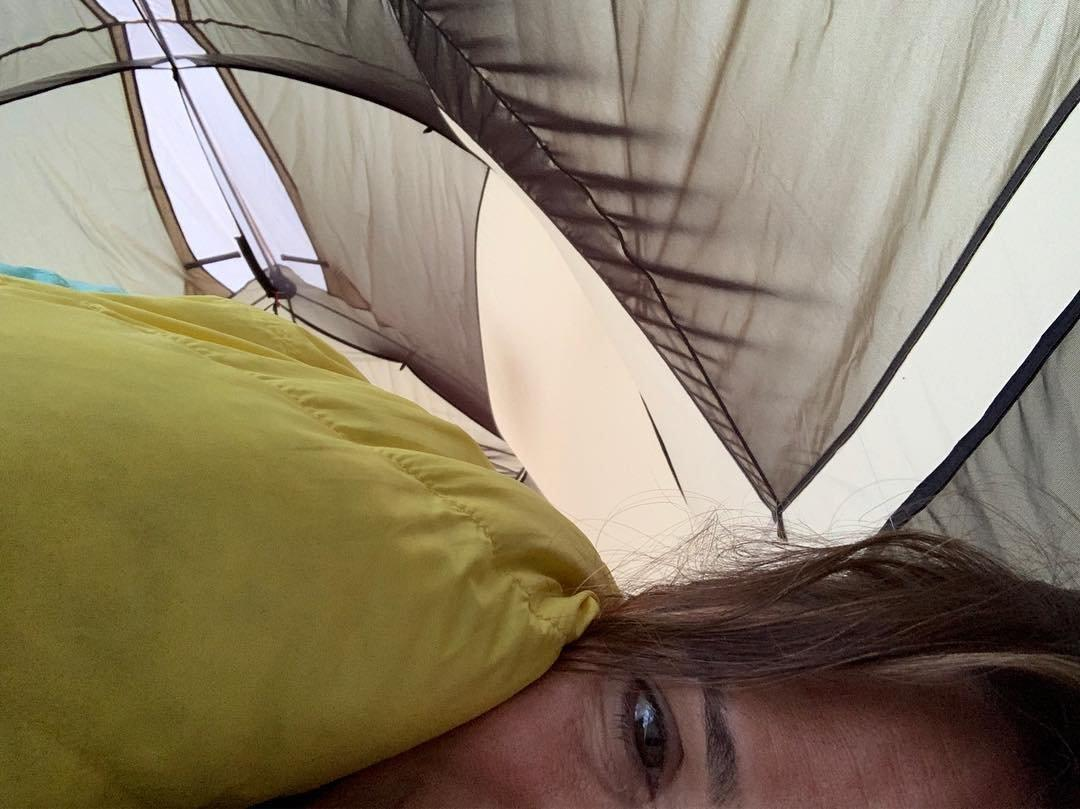 """When she did her best to """"camp"""" with her kids, she was in dire need of coffee. She captioned this sleeping bag snap, """"Backyard campout. Kids still sleeping. Sprinklers. 😑 #👵🏼👵🏼👵🏼 #whencanihavecoffee"""""""